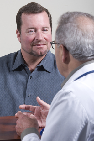 Man talking with doctor.