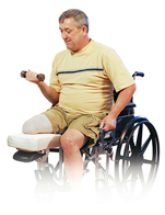 Man with amputated leg sitting in wheelchair exercising with hand weight.