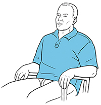 Man sitting in chair doing pursed-lip breathing.