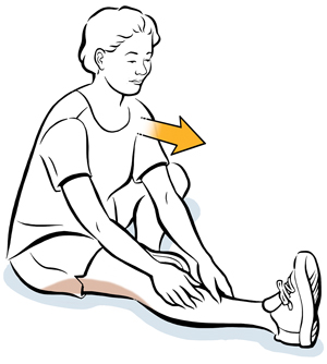 Seated woman doing hamstring stretch.