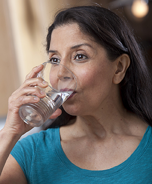 Woman drinking glass of water.