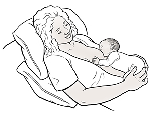 Woman breastfeeding baby in laid-back position.