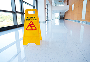 Yellow sign on floor cautioning wet floor.