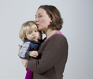 Woman holding toddler girl.